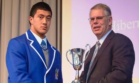 Hibernian Society Vice President, Phiip Horan present Phil Peni, Captian of the St Patrick's College Wellington 1st XV with the Hibernian Cup for 2012. (Photo Courtesy of Iwar Treskon)
